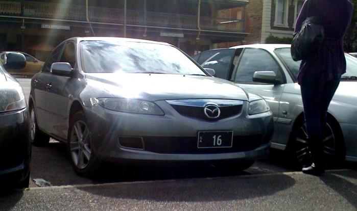 Image: [   16 ] SA Numeric Plate - grey Mazda